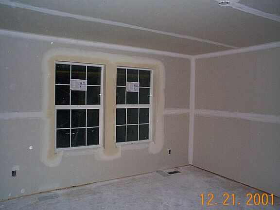 The stucco guy did a little more base coat on the garage for Drywall around windows